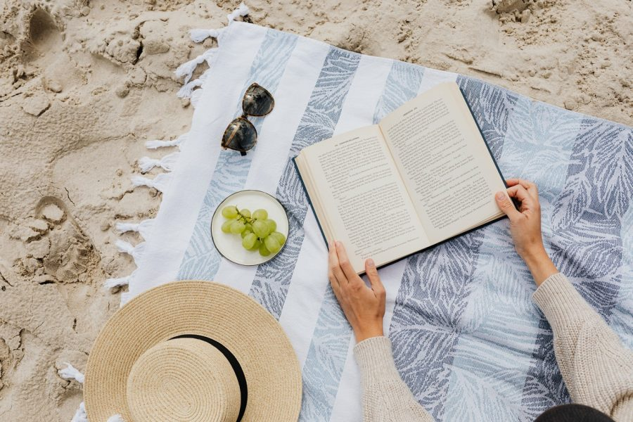 woman with beach read book