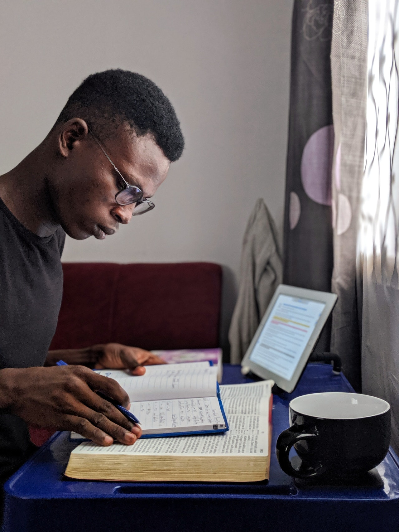man studying in front of computer